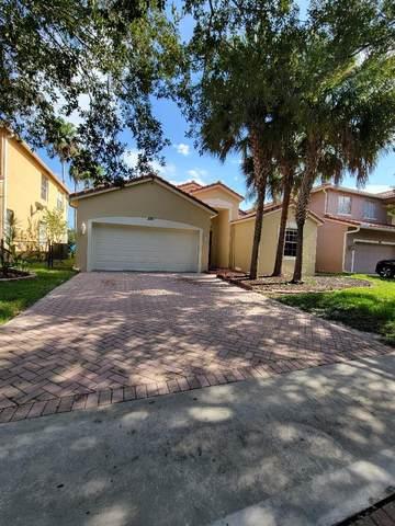 220 Seminole Lakes Drive, Royal Palm Beach, FL 33411 (#RX-10734546) :: Treasure Property Group