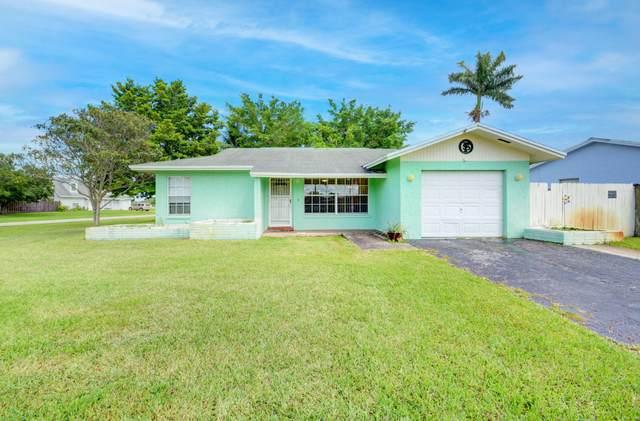 900 Hibiscus Drive, Royal Palm Beach, FL 33411 (#RX-10735005) :: Treasure Property Group