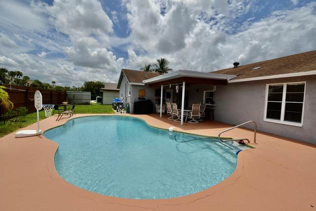 1440 Woodcrest Road E, West Palm Beach, FL 33417 (MLS #RX-10735571) :: THE BANNON GROUP at RE/MAX CONSULTANTS REALTY I