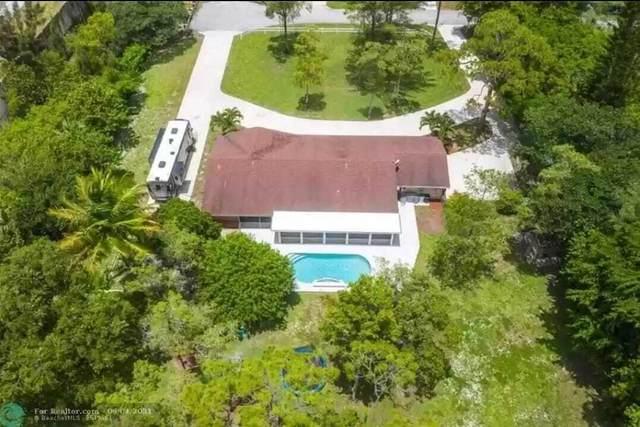 5700 NW 66th Avenue, Parkland, FL 33067 (MLS #RX-10738353) :: Castelli Real Estate Services