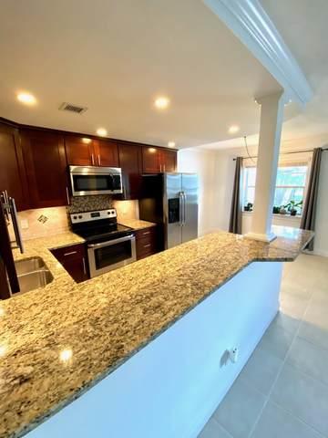 227 Castlewood Drive #106, North Palm Beach, FL 33408 (#RX-10739934) :: Heather Towe | Keller Williams Jupiter