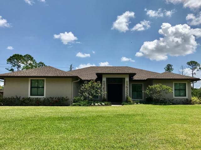 8068 Hall Boulevard, The Acreage, FL 33470 (#RX-10743555) :: Heather Towe | Keller Williams Jupiter