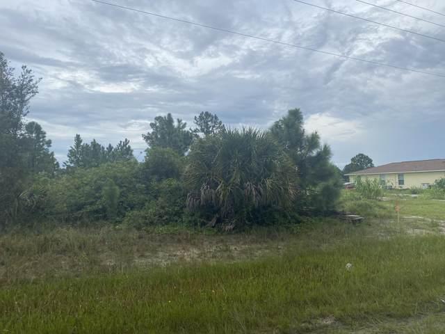 3211 Sunshine Boulevard N, Lehigh Acres, FL 33971 (MLS #RX-10746472) :: Castelli Real Estate Services