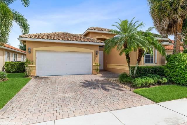 7703 Caprio Drive, Boynton Beach, FL 33472 (MLS #RX-10747056) :: Adam Docktor Group