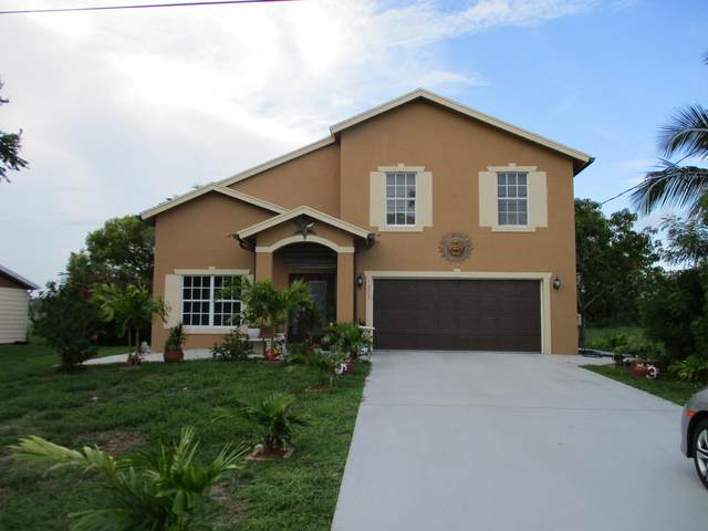 713 SW Tulip Boulevard, Port Saint Lucie, FL 34953 (#RX-10748027) :: IvaniaHomes | Keller Williams Reserve Palm Beach