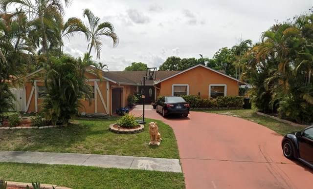 1207 Woodcrest Road W, West Palm Beach, FL 33417 (MLS #RX-10748193) :: Castelli Real Estate Services