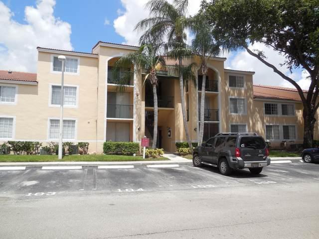1743 Village Boulevard #106, West Palm Beach, FL 33409 (MLS #RX-10752806) :: The Teri Arbogast Team at Keller Williams Partners SW
