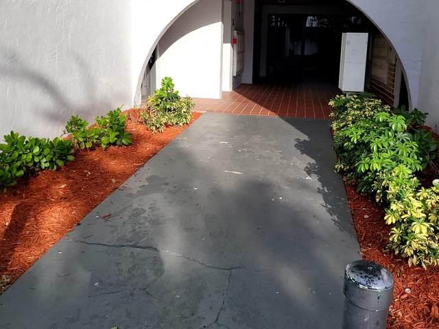 1880 N Congress Ave Avenue G 101, West Palm Beach, FL 33401 (MLS #RX-10753661) :: Berkshire Hathaway HomeServices EWM Realty