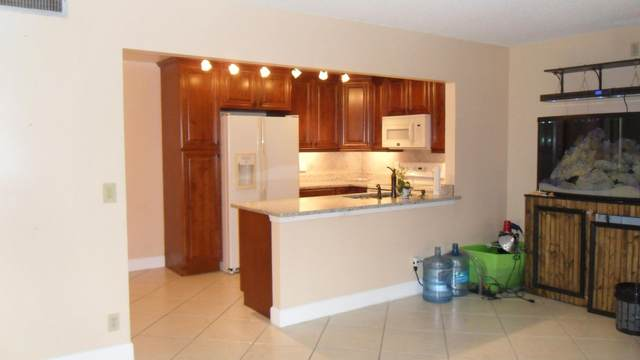 717 Sunny Pine Way A1, Greenacres, FL 33415 (#RX-10754265) :: IvaniaHomes | Keller Williams Reserve Palm Beach
