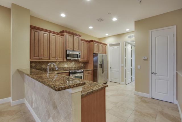 4710 Artesa Way E, Palm Beach Gardens, FL 33418 (MLS #RX-10504716) :: EWM Realty International