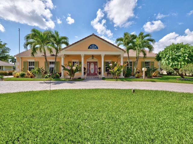 209 N Country Club Drive, Atlantis, FL 33462 (MLS #RX-10508633) :: Berkshire Hathaway HomeServices EWM Realty