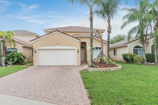 5002 Pebblebrook Terrace, Coconut Creek, FL 33073 (MLS #RX-10537910) :: Berkshire Hathaway HomeServices EWM Realty