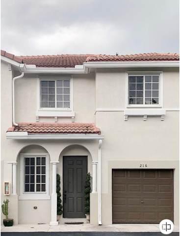 21431 NW 13th Court #216, Miami Gardens, FL 33169 (MLS #RX-10658494) :: Berkshire Hathaway HomeServices EWM Realty