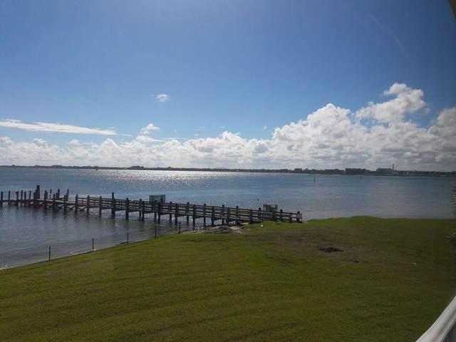 30 Harbour Isle Drive W #206, Hutchinson Island, FL 34949 (#RX-10707080) :: Real Treasure Coast