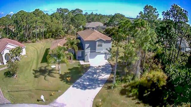 5865 NW Adger Court, Port Saint Lucie, FL 34986 (#RX-10505334) :: The Reynolds Team/Treasure Coast Sotheby's International Realty