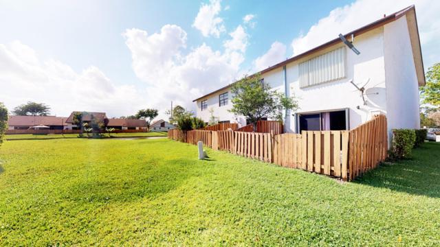 1030 Parkside Green Drive A, Greenacres, FL 33415 (MLS #RX-10515415) :: The Paiz Group