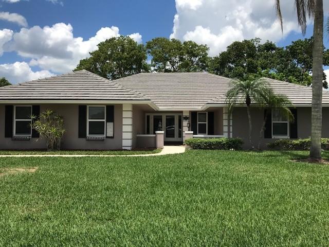 100 Dunbar Road E, Palm Beach Gardens, FL 33418 (#RX-10434537) :: The Reynolds Team/Treasure Coast Sotheby's International Realty
