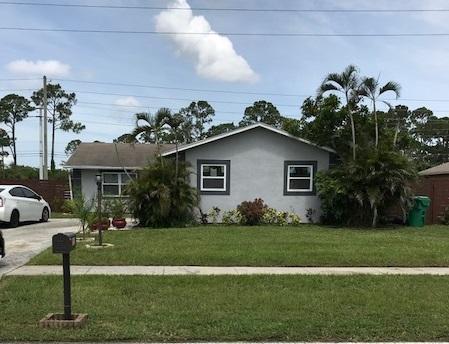 211 Canterbury Drive W, Riviera Beach, FL 33407 (#RX-10440387) :: The Haigh Group | Keller Williams Realty