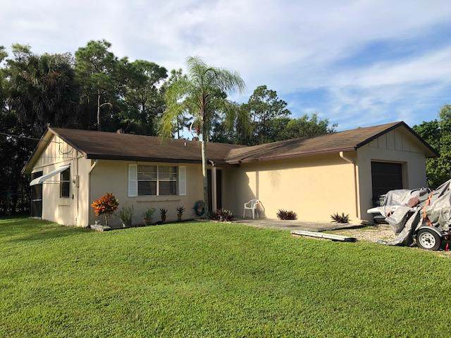 12810 56th Place N, The Acreage, FL 33470 (#RX-10572606) :: Harold Simon   Keller Williams Realty Services