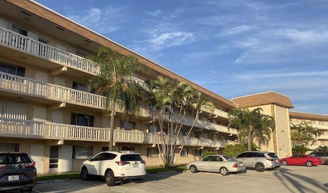 300 Village Green Circle S #107, Palm Springs, FL 33461 (#RX-10579282) :: Ryan Jennings Group