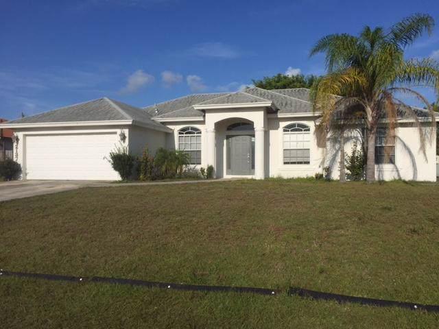 2137 SW Idaho Lane, Port Saint Lucie, FL 34953 (#RX-10582771) :: Ryan Jennings Group