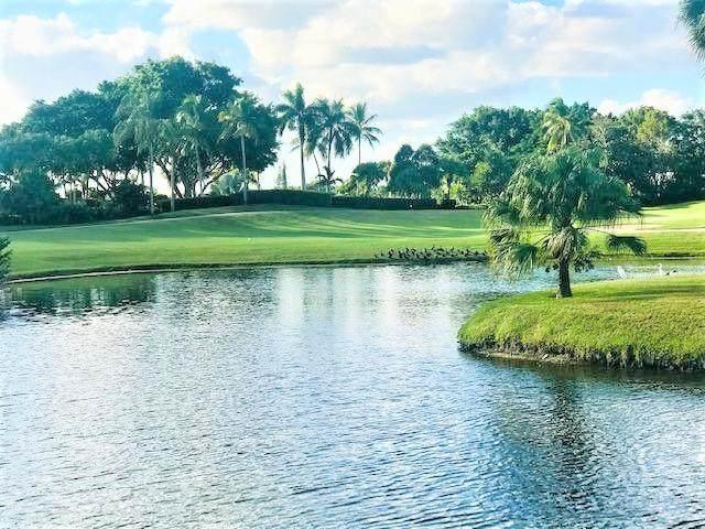 5540 Tamberlane Circle #117, Palm Beach Gardens, FL 33418 (MLS #RX-10602279) :: Berkshire Hathaway HomeServices EWM Realty