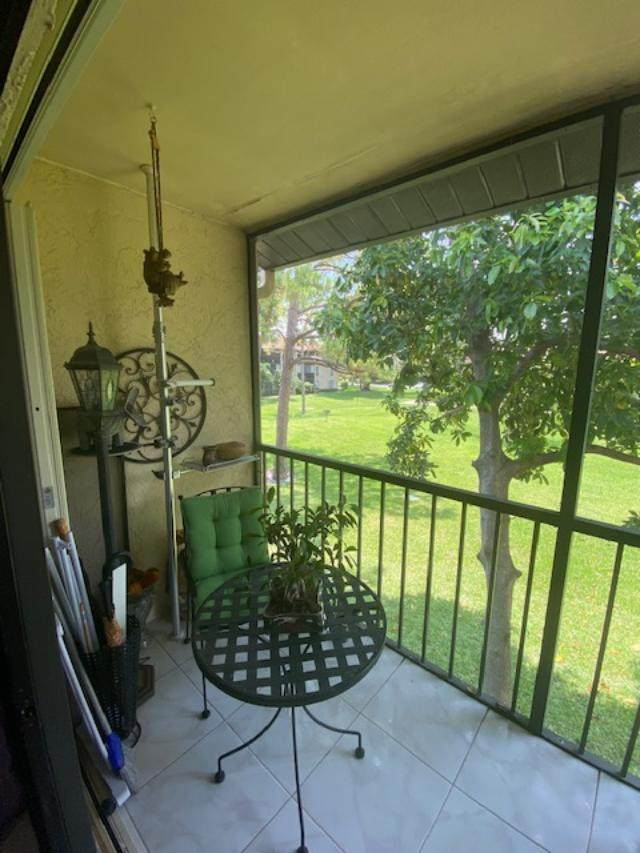 718 Sunny Pine Way F2, Greenacres, FL 33415 (MLS #RX-10626247) :: Berkshire Hathaway HomeServices EWM Realty