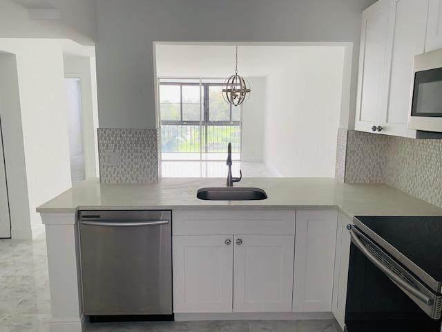 6795 Huntington Lane #303, Delray Beach, FL 33446 (#RX-10628915) :: Ryan Jennings Group