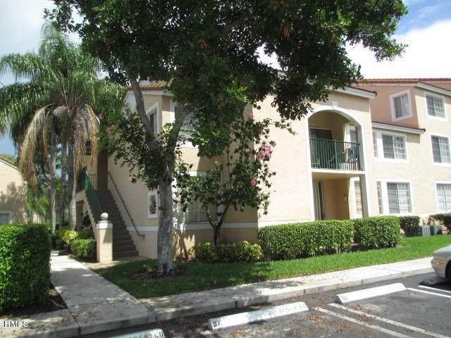 1743 Village Boulevard #202, West Palm Beach, FL 33409 (MLS #RX-10633063) :: Berkshire Hathaway HomeServices EWM Realty