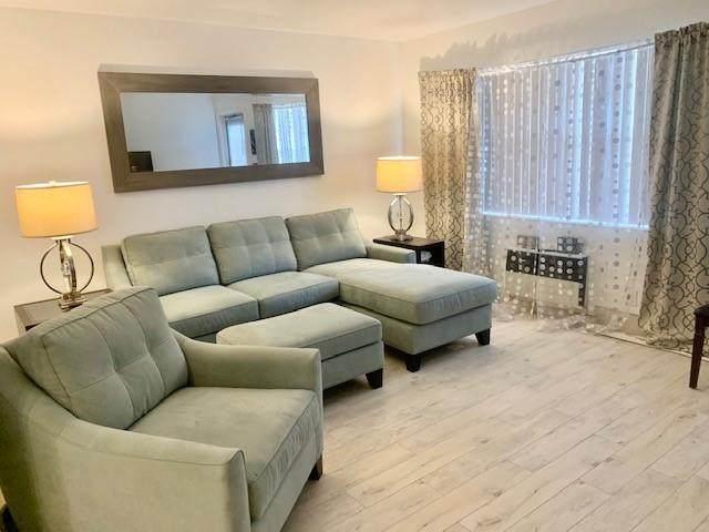 69 Kingswood D, West Palm Beach, FL 33417 (#RX-10679033) :: Signature International Real Estate