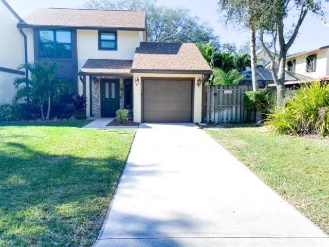 1083 Raintree Drive, Palm Beach Gardens, FL 33410 (#RX-10684966) :: Exit Realty Manes Group