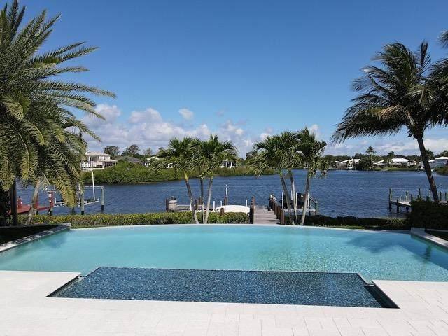 104 Victory Drive, Jupiter, FL 33477 (MLS #RX-10716474) :: Castelli Real Estate Services