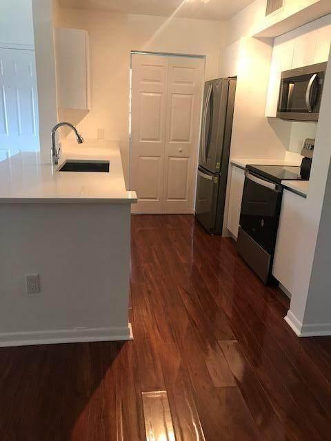 110 Yacht Club Way #201, Hypoluxo, FL 33462 (#RX-10734132) :: Posh Properties