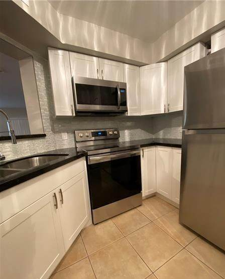 2445 NW 33rd Street #1401, Oakland Park, FL 33309 (MLS #RX-10666673) :: Berkshire Hathaway HomeServices EWM Realty
