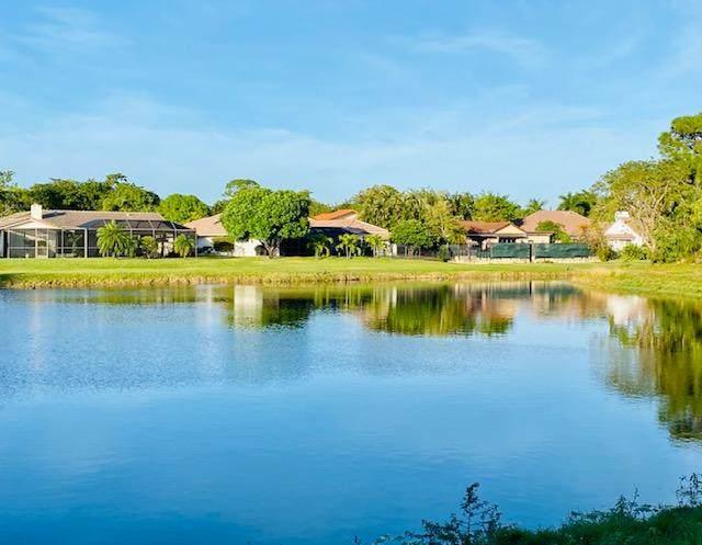 5700 Camino Del Sol #107, Boca Raton, FL 33433 (MLS #RX-10674124) :: Berkshire Hathaway HomeServices EWM Realty