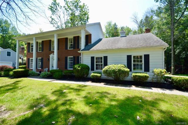 8235 Clarherst Drive, Clarence, NY 14051 (MLS #B1208929) :: Robert PiazzaPalotto Sold Team