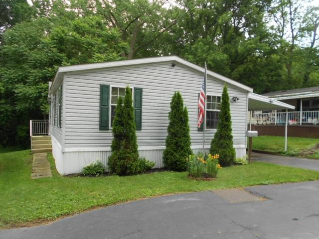 19 1/2 Spinet Drive, Penfield, NY 14625 (MLS #R1057501) :: Robert PiazzaPalotto Sold Team