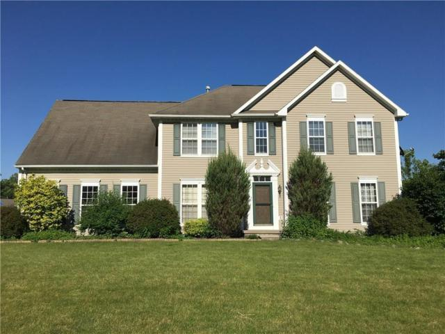 1 Schoolmaster Circle, Perinton, NY 14450 (MLS #R1135379) :: The CJ Lore Team | RE/MAX Hometown Choice