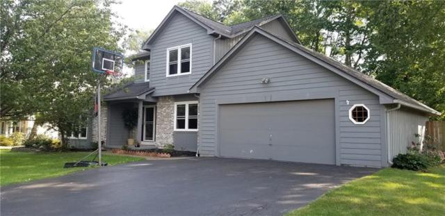 445 Thrushwood Lane, Webster, NY 14580 (MLS #R1149099) :: The CJ Lore Team | RE/MAX Hometown Choice