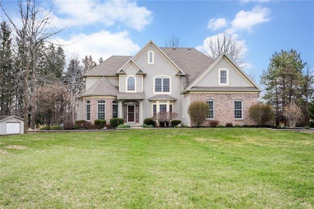 15 Ashland Oaks Circle, Ogden, NY 14559 (MLS #R1185025) :: Robert PiazzaPalotto Sold Team