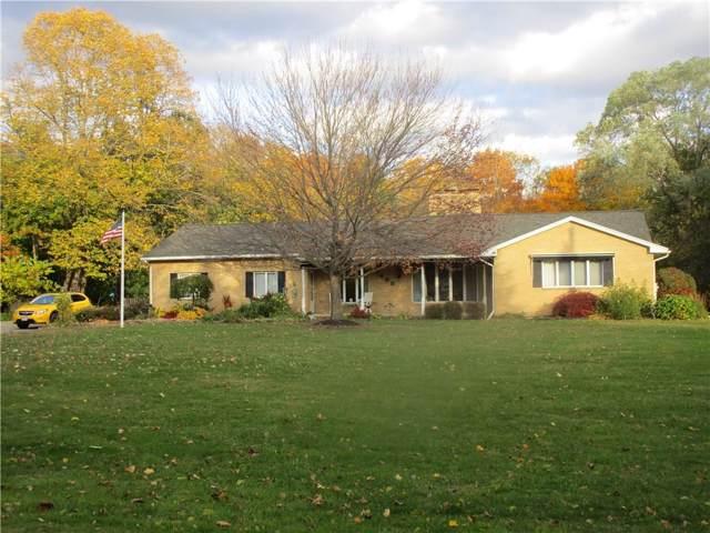1400 Hogan Road, Penfield, NY 14580 (MLS #R1235882) :: The CJ Lore Team | RE/MAX Hometown Choice