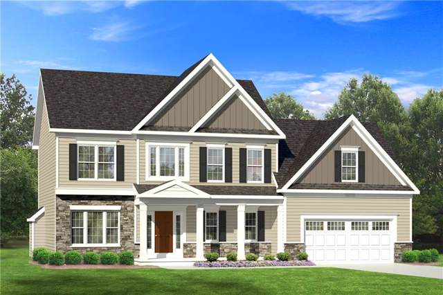 140 Country Village Lane, Parma, NY 14468 (MLS #R1247528) :: The Chip Hodgkins Team