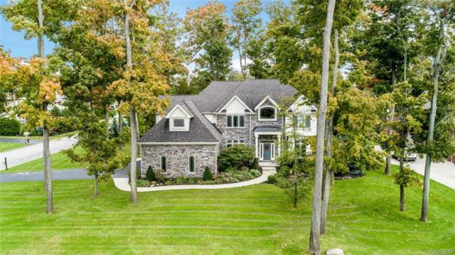 4989 Rockhaven Drive, Clarence, NY 14031 (MLS #B1154669) :: The CJ Lore Team | RE/MAX Hometown Choice