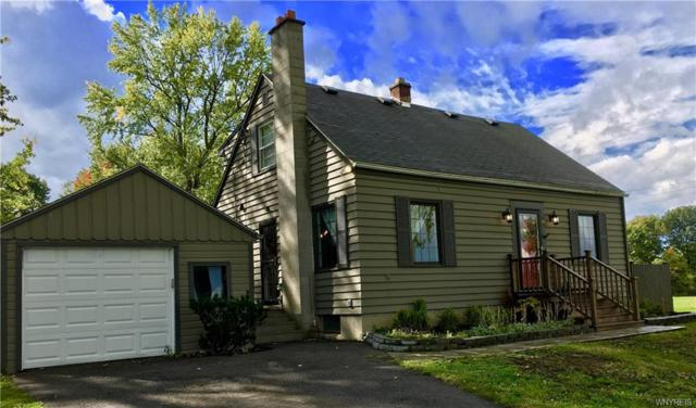 8795 Sheridan Drive, Clarence, NY 14221 (MLS #B1155403) :: The CJ Lore Team | RE/MAX Hometown Choice