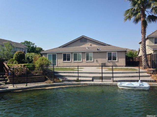1424 Oasis Lane, Patterson, CA 95363 (MLS #17073378) :: The Del Real Group