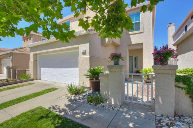9090 Trumbauer Way, Elk Grove, CA 95758 (MLS #18040537) :: Gabriel Witkin Real Estate Group