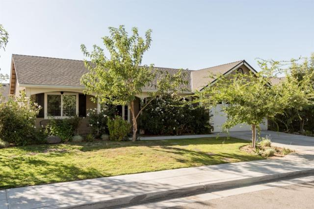 2457 N Milburn Avenue, Fresno, CA 93722 (MLS #18066281) :: The Del Real Group
