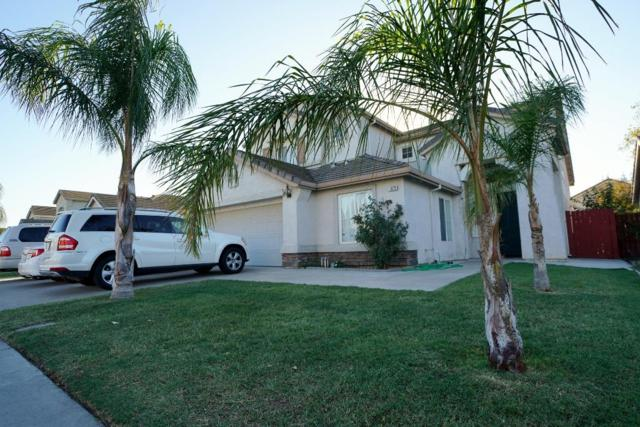 1879 Hyde Park Lane, Manteca, CA 95336 (MLS #18072094) :: The Del Real Group