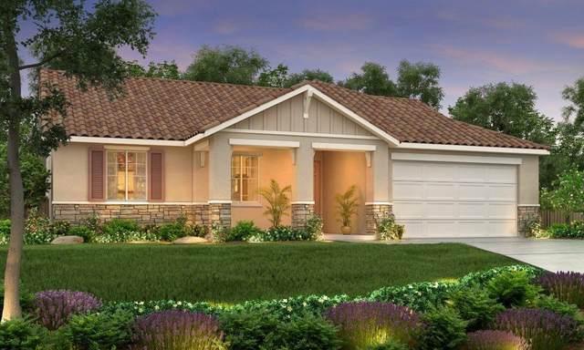 2034 Gus Villalta Drive, Los Banos, CA 93635 (MLS #20019995) :: The MacDonald Group at PMZ Real Estate