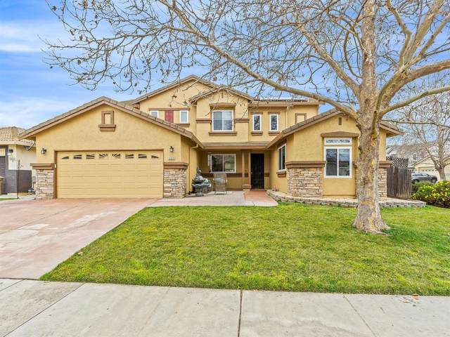 9309 Winding Brook Way, Elk Grove, CA 95624 (MLS #20070854) :: The MacDonald Group at PMZ Real Estate